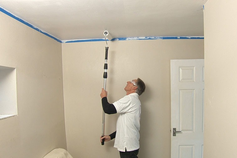 Use a 9 inch roller and extension pole to quickly paint the ceiling.