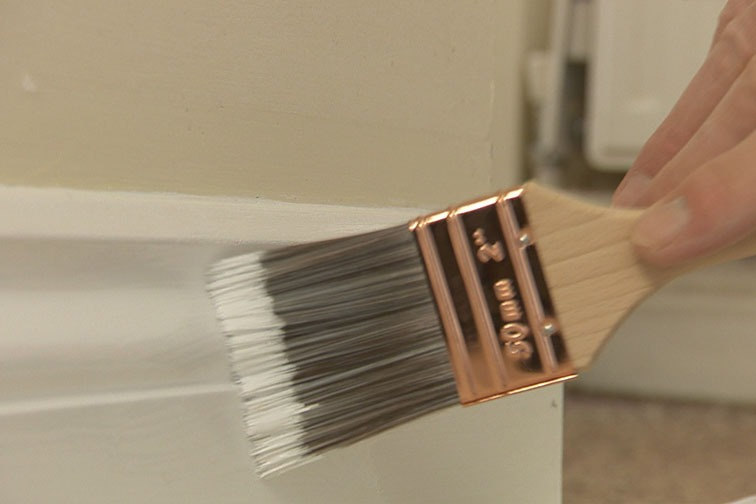 Paint on an undercoat first using the flat woodwork brush.