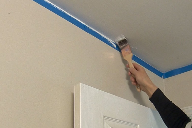Use the Angled Reach Brush to cut in around the edges of the ceiling.