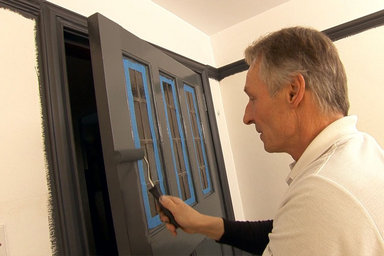 Use the gloss roller to paint the larger flat sections of the door.