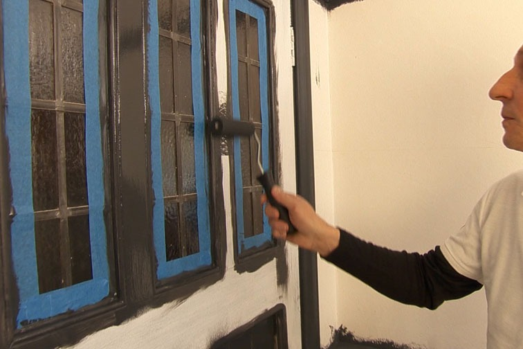 Use a Mini Roll with Gloss Sleeve to paint the flat sections of the door.